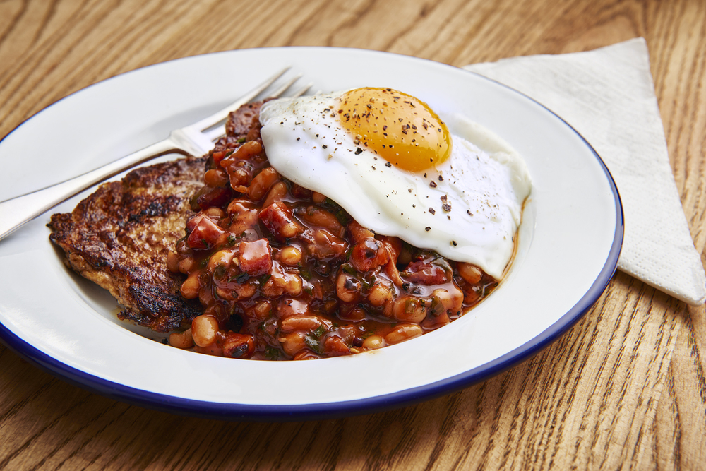 Honest Burgers breakfast menu, french toast guinness eggy bread with honest baked beans made from heinz and a fried egg with a yellow yolk. Photographed by London food and still life photographer Scott Grummett.