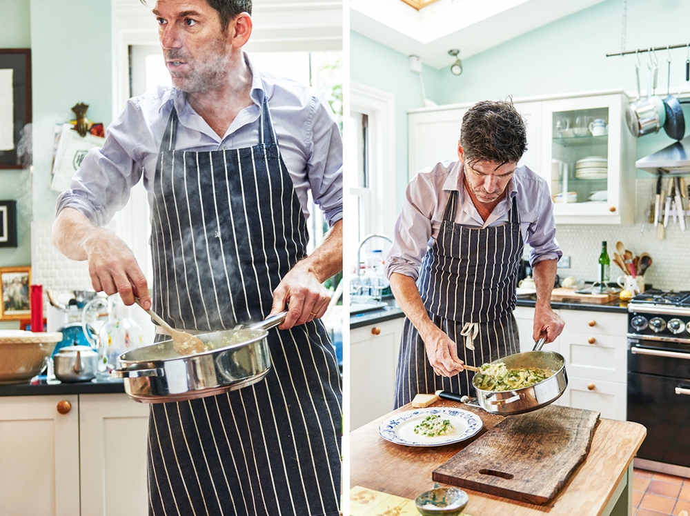 Russell Norman The Relectant Cook shot for Esquire Magazine in the UK as an editorial commission. Food photographer scott grummett represented by Shoot Group and P for Production shoots restaurant man Russell Norman as portraits. Scott shoots food photography and is a director based in London. Image includes: kitchen chef food photography food photographer london country kitchen russell norman cooking cookery recipe book editorial packaging advertising pr social media press below the line above the line chopping shallots shallots apron shirt polpo holding pan steam onions stirring serving spooning plate preparation risotto primavera photographers
