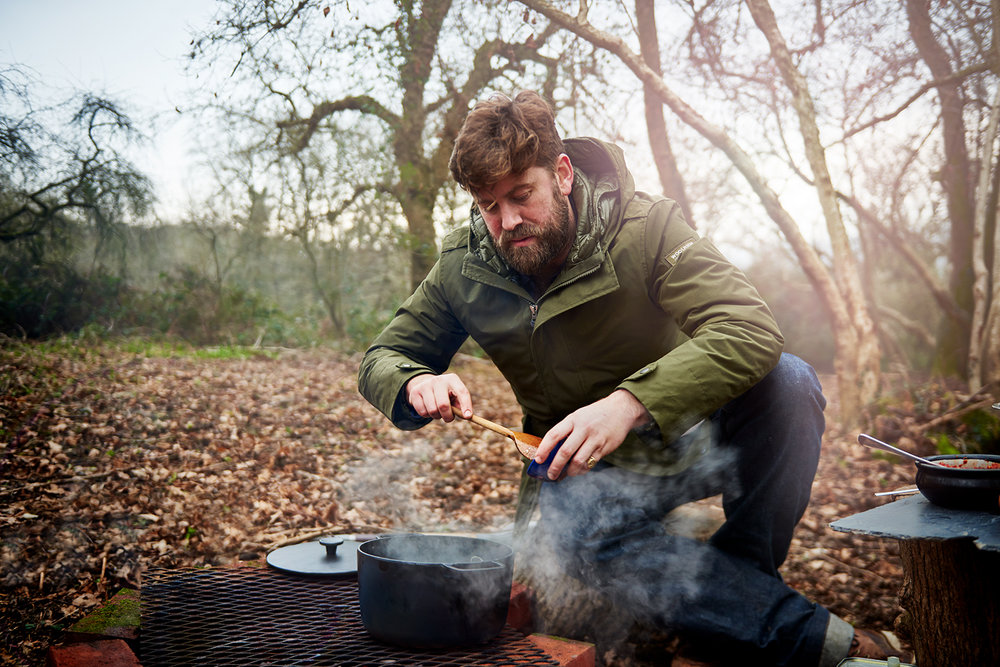 food photographer london scott grummett food and drink advertising lifestyle documentary woods forest chef freddy bird freddie fire barbecue bbq cooking bricks grill griddle monkfish chickpeaks chick peas lamb aubergine flames smoke wood logs beard hands flame flames match matches matchbox match box sticks bonfire mussels mussel shellfish clams sherry wine molasses cast iron castiron steam smoke