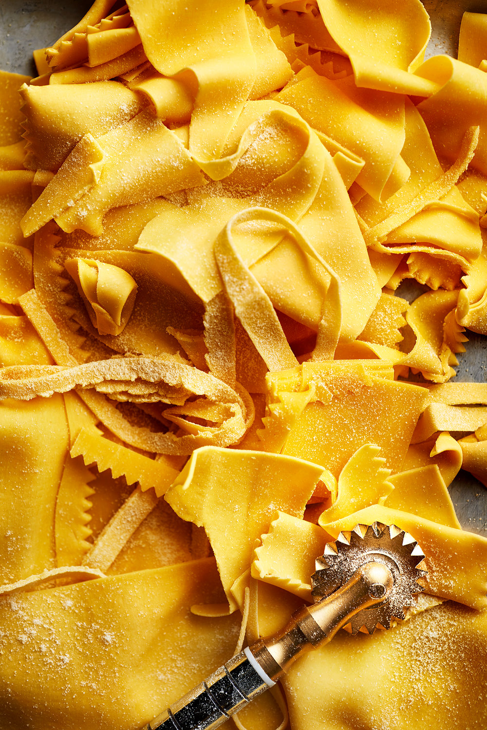 food photographer photography drink pasta recipe recipes hand made fresh prepared documentary provenance cooking cook cookbook recipe making process steps step by step black and white hands hand cutter cutting tool tools tortellini tortelloni lasagne tools pasta making overhead brass cutter roller brush extruder press oxtail ox tail ragu bolognese parpadelle tagliatelle scott grummett