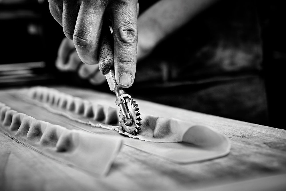 food-photographer-photography-drink-pasta-recipe-recipes-hand-made-fresh-prepared-documentary-provenance-cooking-cook-cookbook-recipe-making-process-steps-step-by-step-black-and-white-hands-hand-cutter-cutting-tool-tools-tortellini-tortelloni-lasagne-tools-pasta-making-overhead-brass-cutter-roller-brush-extruder-press-oxtail-ox-tail-ragu-bolognese-parpadelle-tagliatelle.jpg