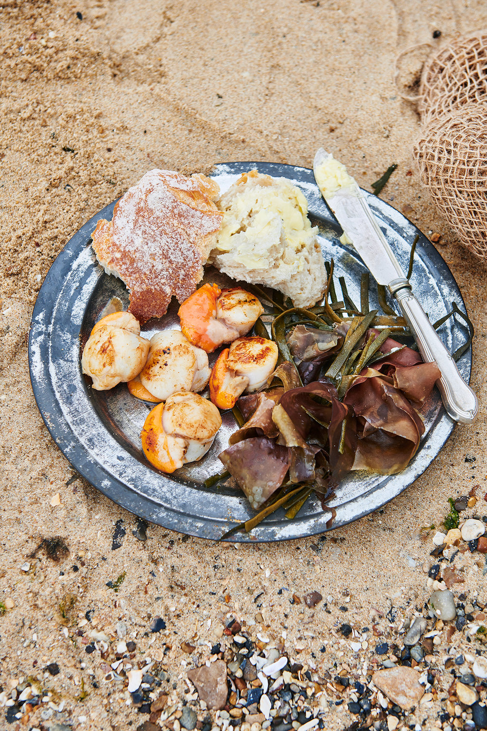 scott grummett food drink photographer london documentary sea beach lucy ruth hathaway jess elcock jessica esse bbq barbecue fish seafood sea food shellfish mackerel mussels prawns bass fillet cooking cook cookbook recipe doc documentary photographer photography beach coast coastal erosion trees tree cliff crate deckchair deck chair hamper hampers lantern grill griddle mussel mussels colainder colander seabass bass sea fire cooking smoke bbq barbecue wood coals coal charcoal scallop scallops seaweed pebbles pebble prawn prawns king tiger shelling griddle fry