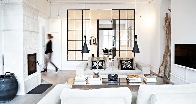 living room encasement windows black pendant lights.jpg