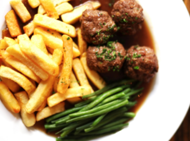 Meatballs de Liege, a classic Belgian dish with a Brugse Zot burn gravy, fries and green beans.