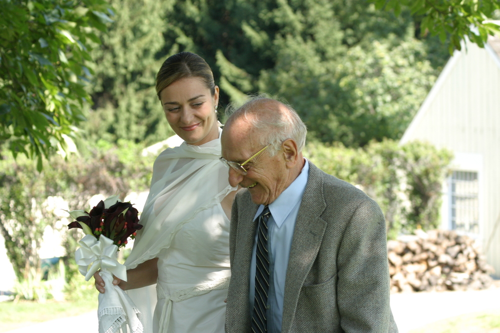 My Gramps walked me down the isle...Well, the grass...We got married on our lawn.