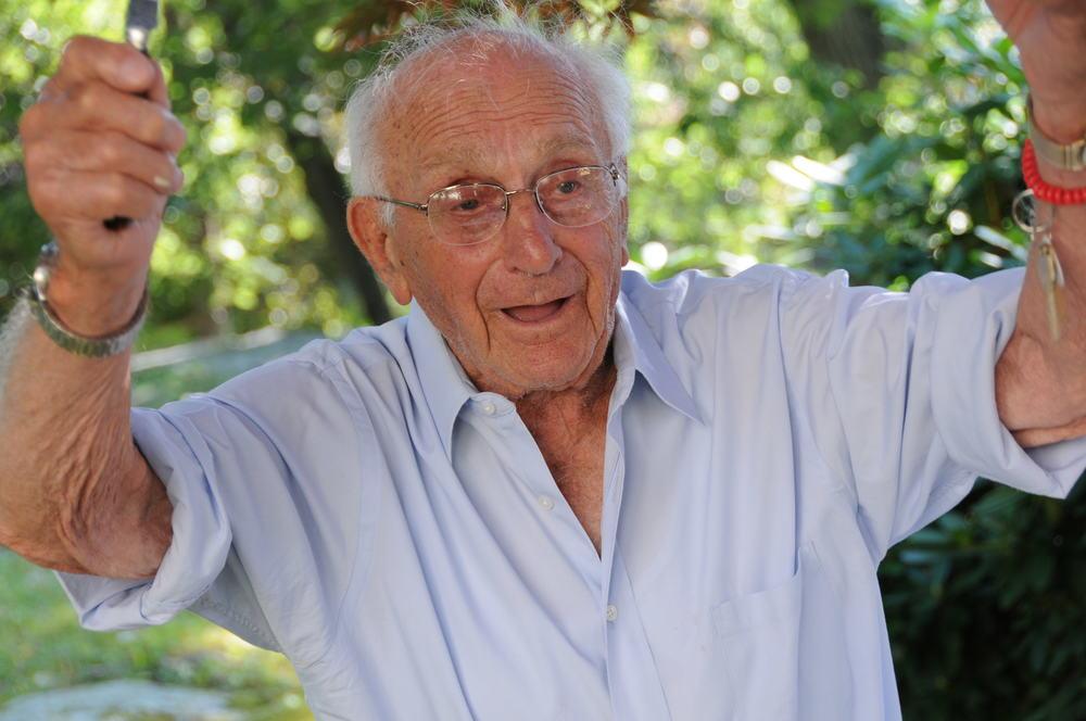 Conducting his Happy Birthday song at age 100