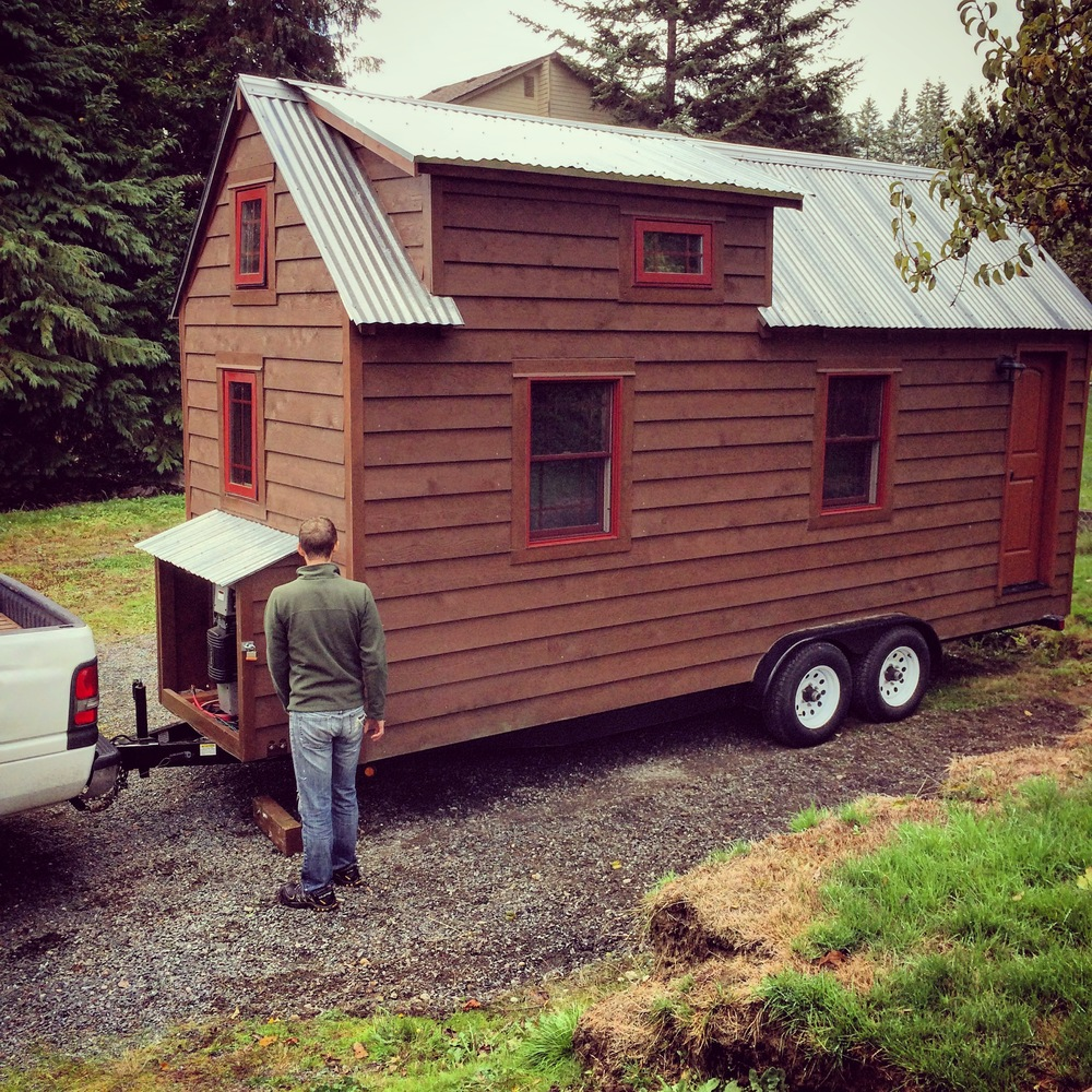 Brock and Christopher getting The Tiny Tack House into position.
