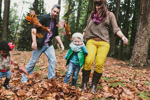 kicking leaves in the park family photography
