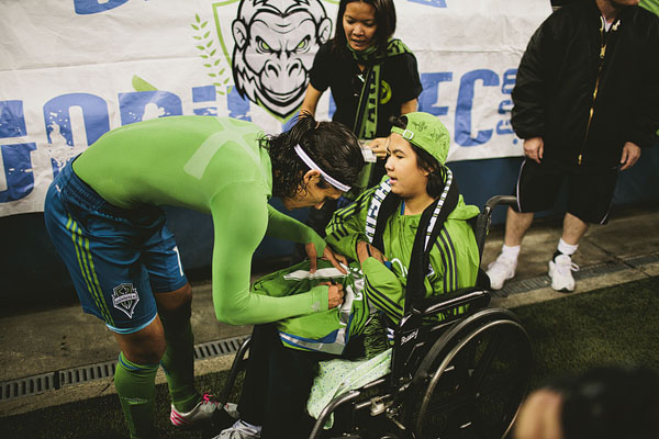 Fredy Montero signs for a fan