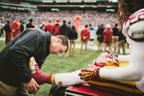 USC coach taping ankle of player
