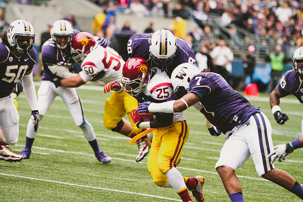 Silas Redd getting tackled UW