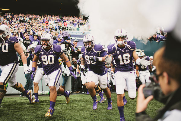 Huskies running onto field