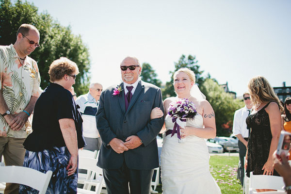 father and bride walk down aisle