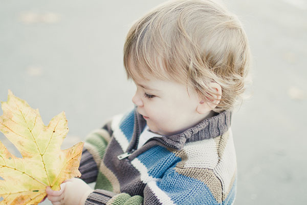 toddler with a leaf