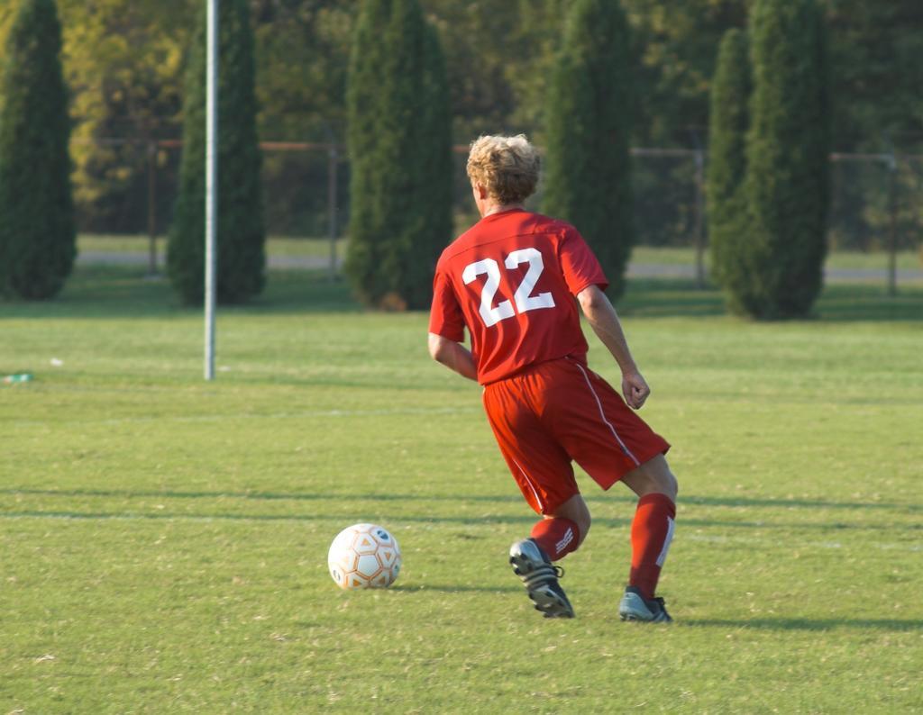 Matt serving from right in a WUSTL soccer game