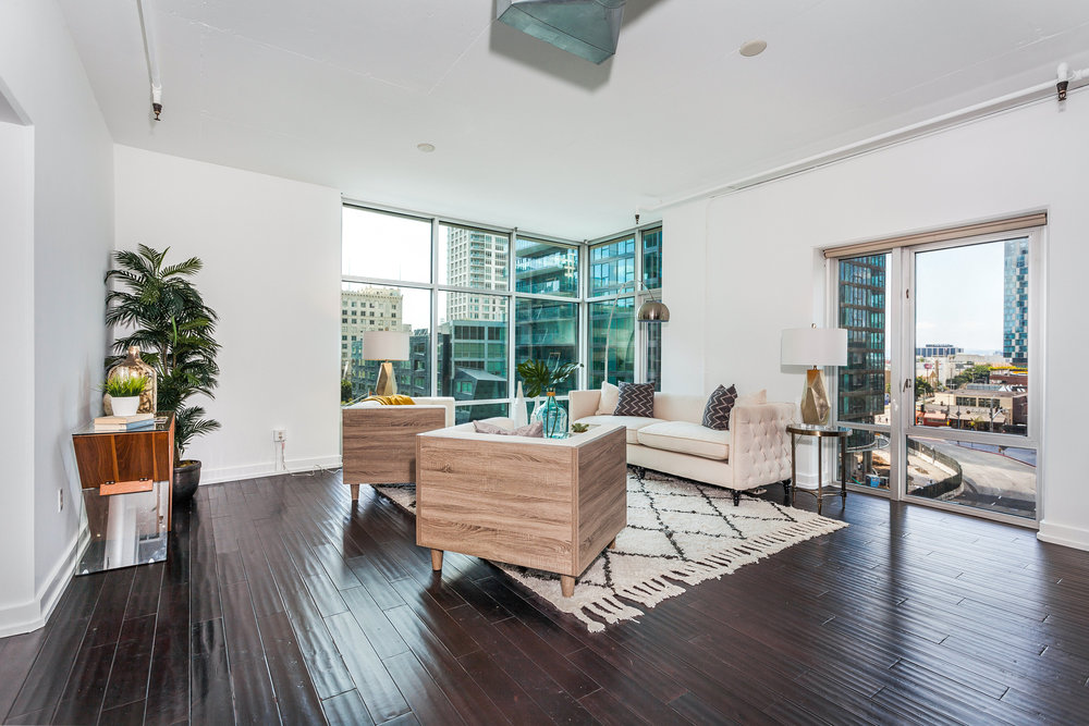 condo living room with dark wood floors
