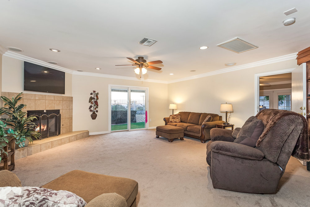 view of family room with fireplace