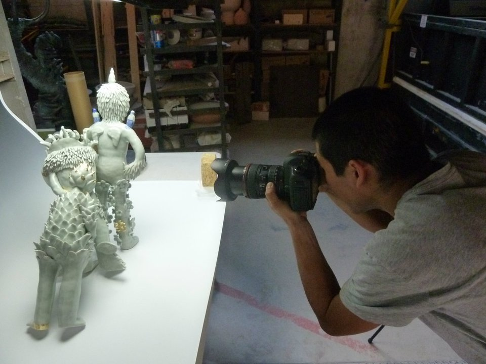 Triple figurine piece is being photographed by Dustin Trey