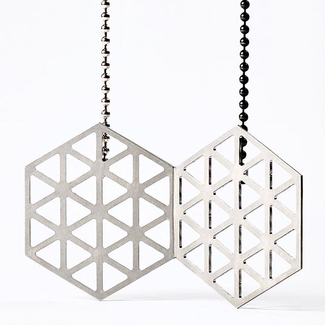 Silver and steel geometric jewellery #Steel #silver #jewelry #jewellery #sculpture #brooch #pendant #design #contemporary-jewellery #australiandesign