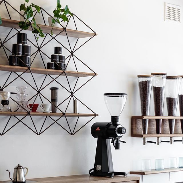 Shelves by @christianhalldesign fit out by @studio_liam_mugavin glass blown by @fleming_liam for Bondi cafe @coffeebondibeach photograph by @barton_taylor #australiandesign #design #furniture #metal #steel #craft #local #coffee #pourover #mahlkonig #ek43