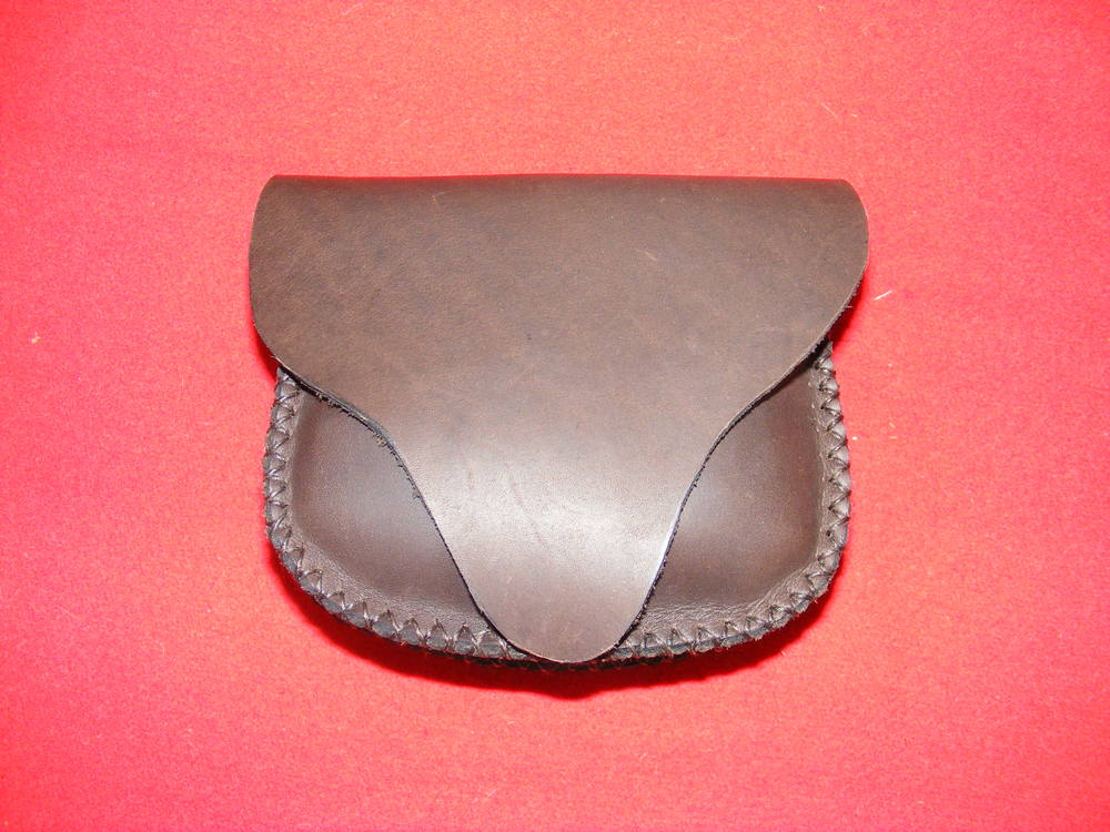 "Medium Beavertail Belt Pouch:  Unlined beavertail Flap, fits belts up to three inches wide  Size: 6"" x 5"" x 1""  Price: $30.00  Inventory Tag: GB-1-M"