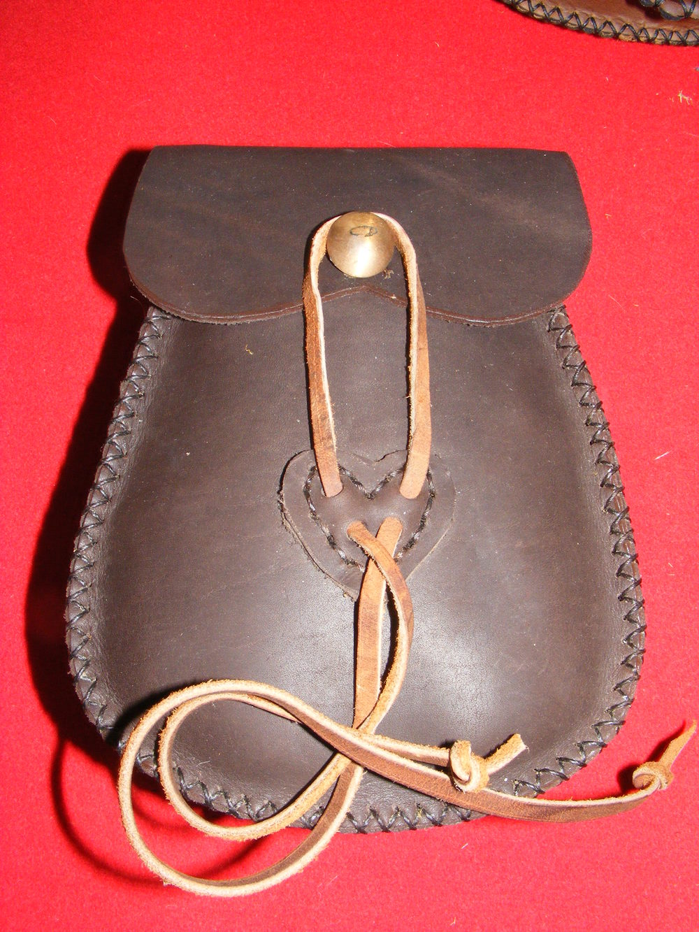"Ladies' Belt Pocket:  Inside pocket, scalloped flap with antler button hold down  Size: 8"" x 6"" x 2 /12""  Price: $35.00  Inventory Tag: GB-5-LB"