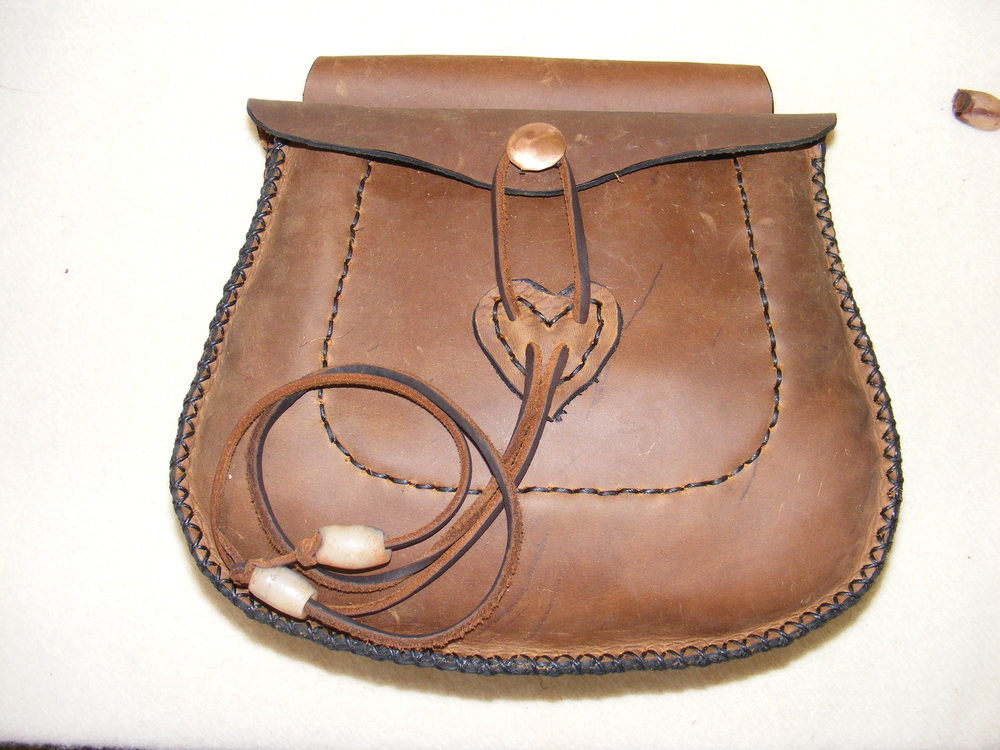 "Very Large Belt Pouch:   Two inside pockets, scalloped flap with antler or brass button. Size: 9"" x 7"" x 2""  Price: $50.00  Inventory Tag: GB-8-BBB"