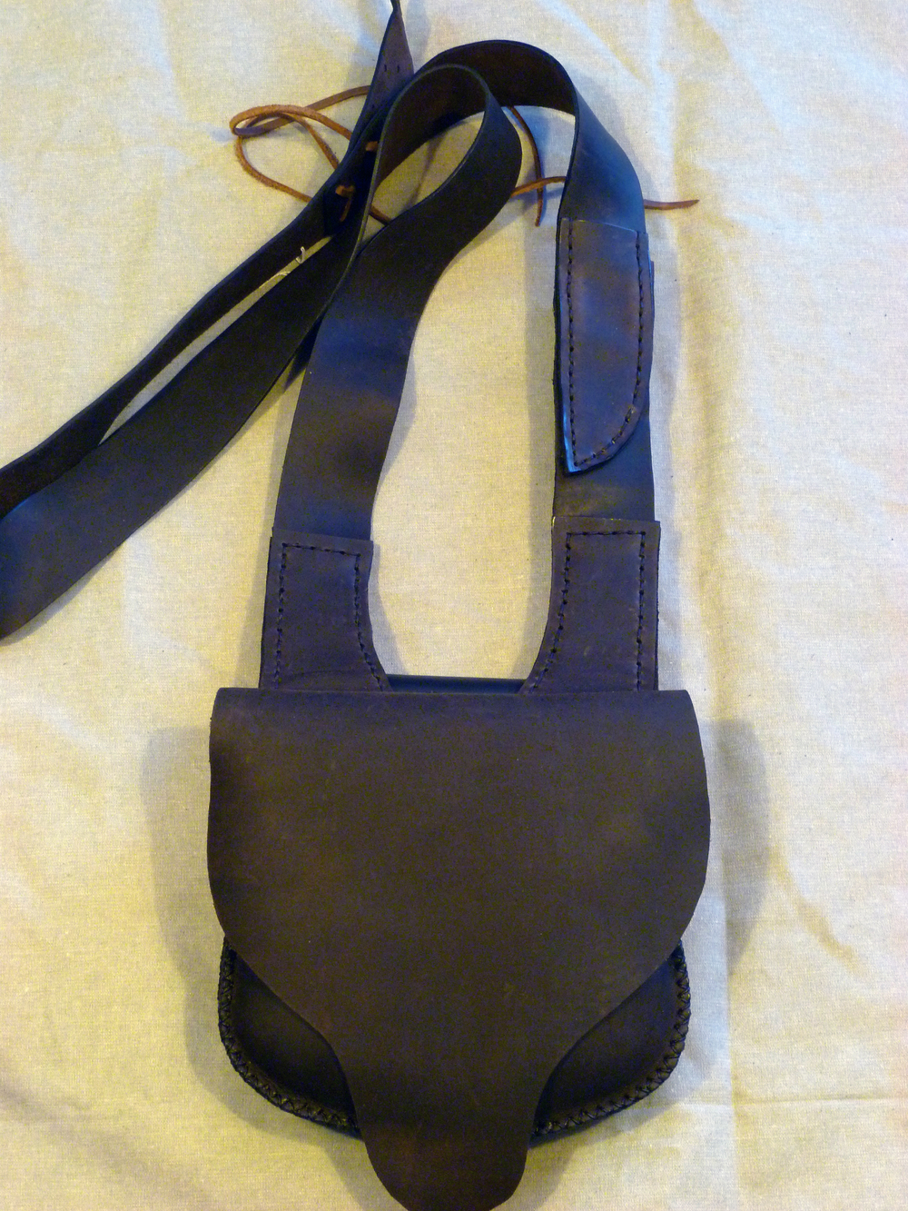 "Single Pouch Shooting Bag w/ Unlined Flap : Two inside  pockets, adjustable leather strap with patch knife sheath on the strap.  Size: 8 1/2""x 7 1/2""x 2""  Price: $65.00  Inventory Tag: GB-2-SG"