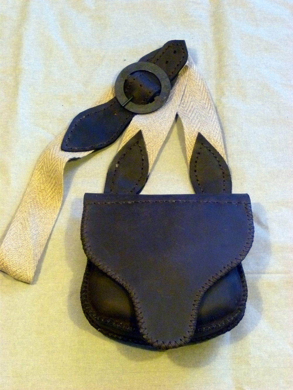 "Single Pouch Shooting Bag, Lined Flap: 2 inside pockets, lined flap with design, patch knife sheath on back.  Size: 8 1/2"" x 7 1/2"" x 2""  Price: $75.00  Inventory Tag: GB-2-SGS"
