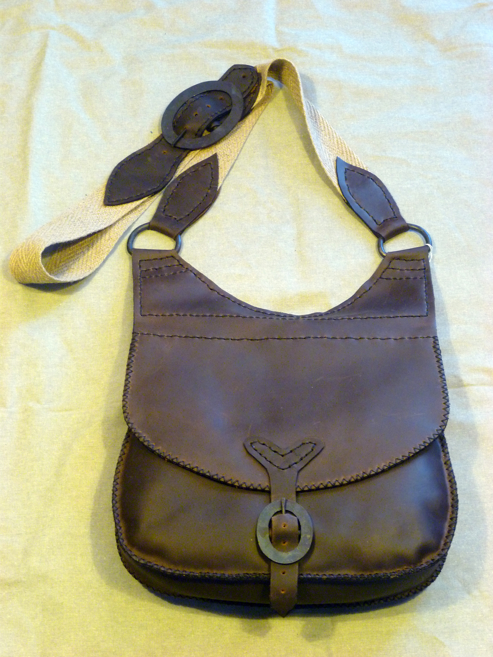 "Large Haversack Shooting Bag with Lined Flap:  This bag is big enough to carry your bread for the long trek with four inside pockets and a sturdy Linsey/Woolsey cloth strap.  Size: 12"" x 12"" x 3""  Price: $125.00  Inventory Tag: GB-4-DBS"