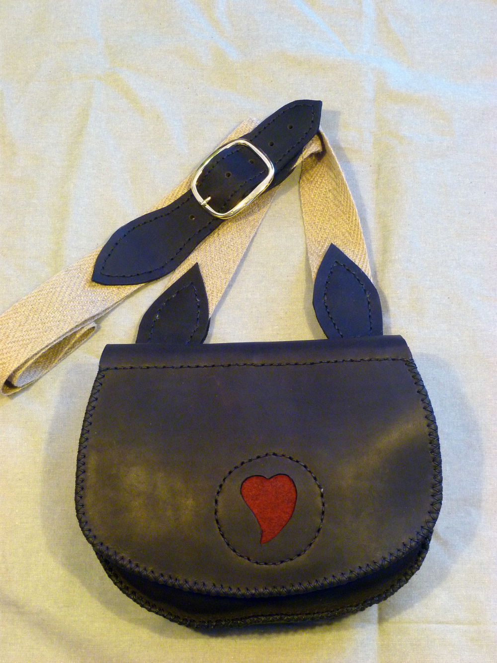 "Small Haversack:  Three inside pockets with or without flap design  Size: 11"" x 9"" x 3""  Price: $80.00  Inventory Tag: GB-6-LDB"