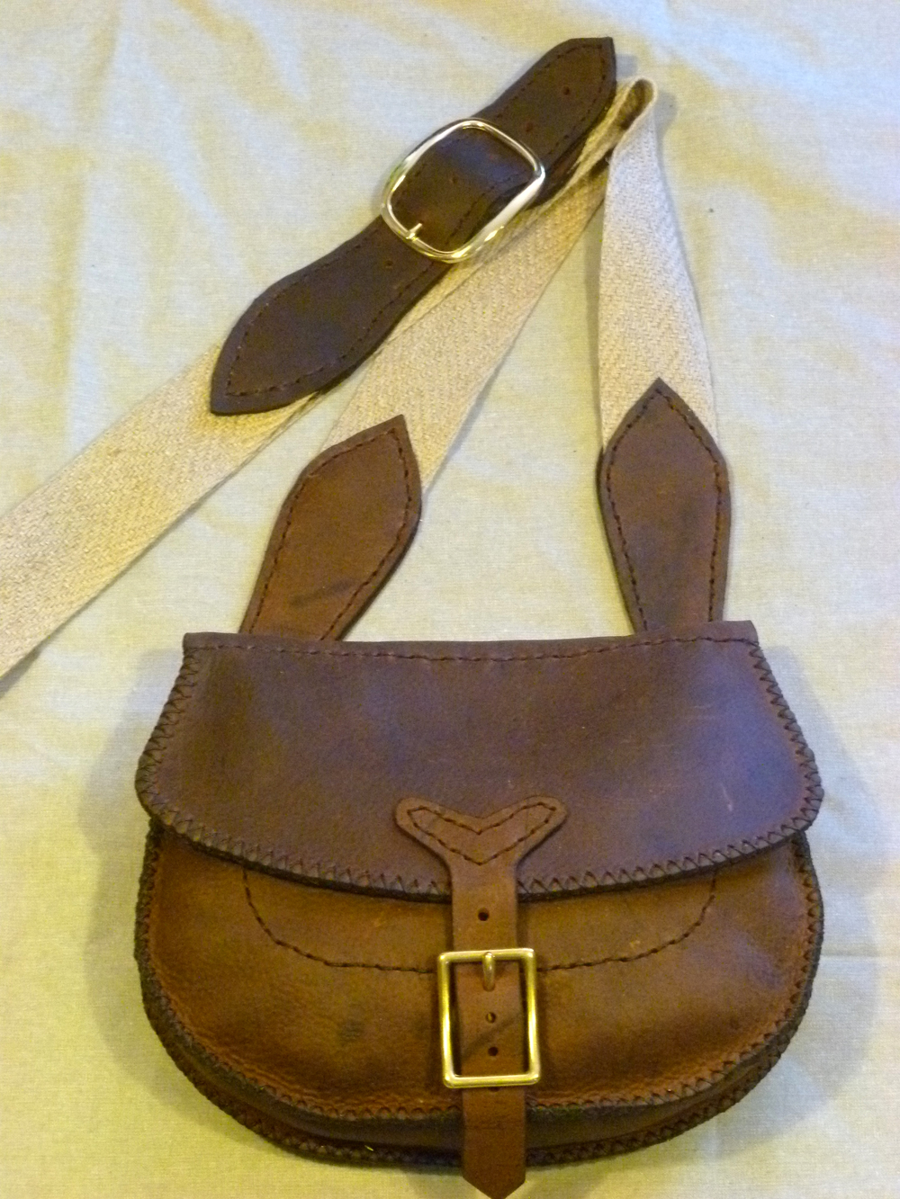 "Small Haversack with Buckled Flap:  Three inside pockets with a brass or iron strap and buckle flap.  Sixe: 11"" x 9"" x 3""  Price: $85.00  Inventory Tag: GB-6-LDBS"