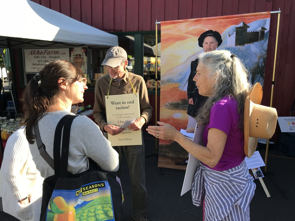 Doug Deaton and I talking to people at Cully Farmers Market in NE Portland.