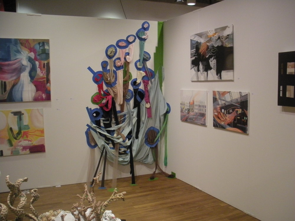 """Intimate Burp"" installation by Alicia Obermeyer; Pantyhose,Painters tape. with paintings on the right by Peyton Rack and on the left by Brandy Kraft."
