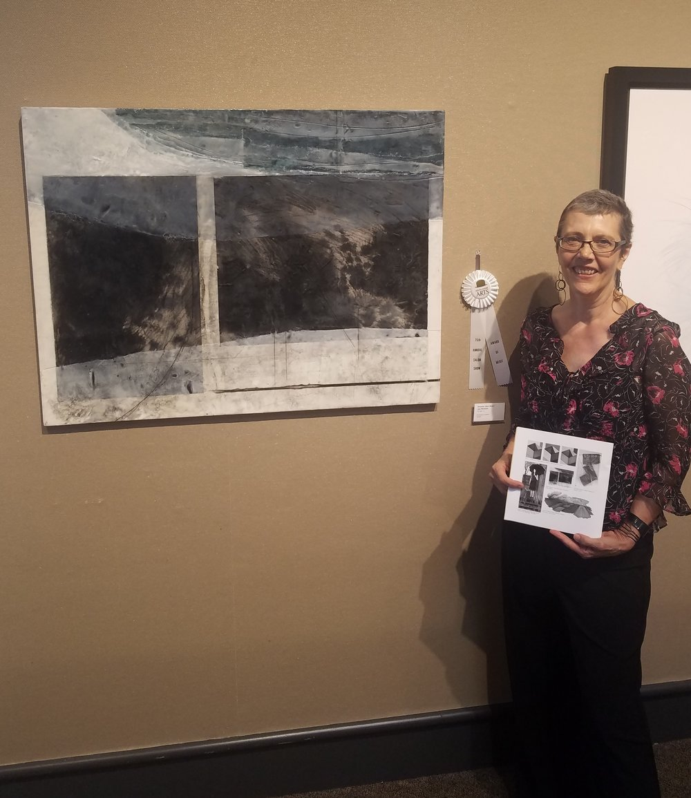 "Jane Michalski with ""Shoreline (Dark Water)"" at the South Shore Arts 75th Annual Salon show"