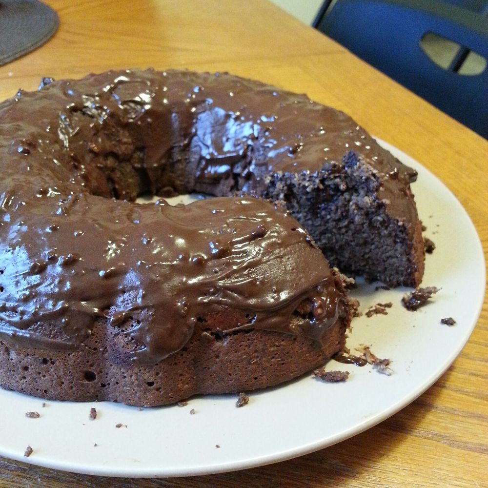 Click for more photos of paleo dark chocolate bundt cake with chocolate chunks and melted chocolate on top