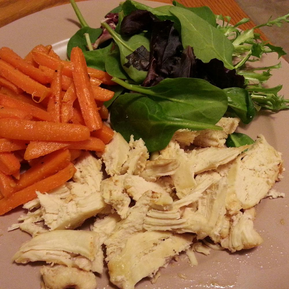baked chicken, sautéed carrots and baby greens