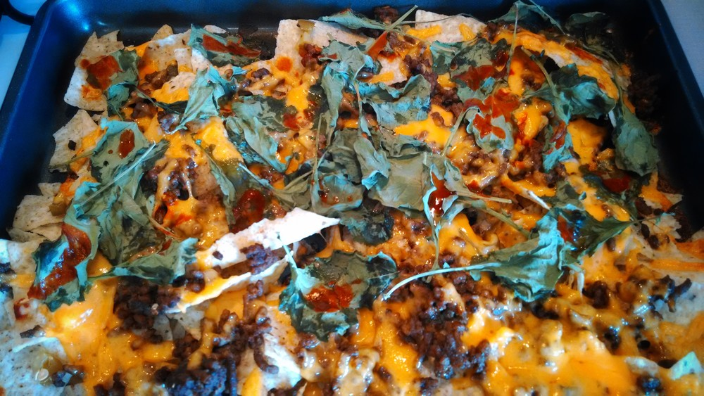 Nachos ft. grass-fed ground beef, chedda, jalapeños, kale, and hot sauce!