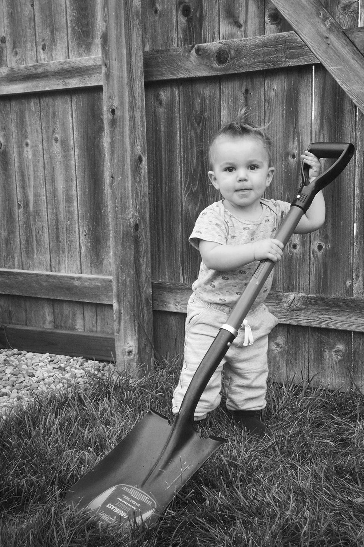 Ryker doing yard work at Grandma and Grandpa's