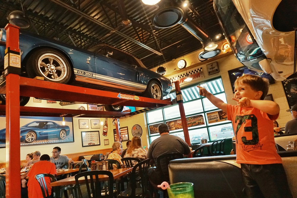 Ryker excited by cars in Quaker Steak n' Lube