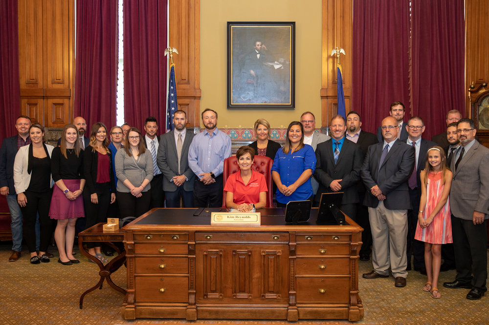 Proclamation signing at Iowa capitol building for Insurance Fraud Awareness day
