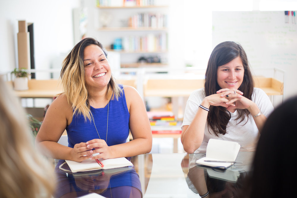 Anxy Magazine Founder Indhira Rojas (left) at Redindhi Studio in conversation with design team. Photo by Michelle Le.