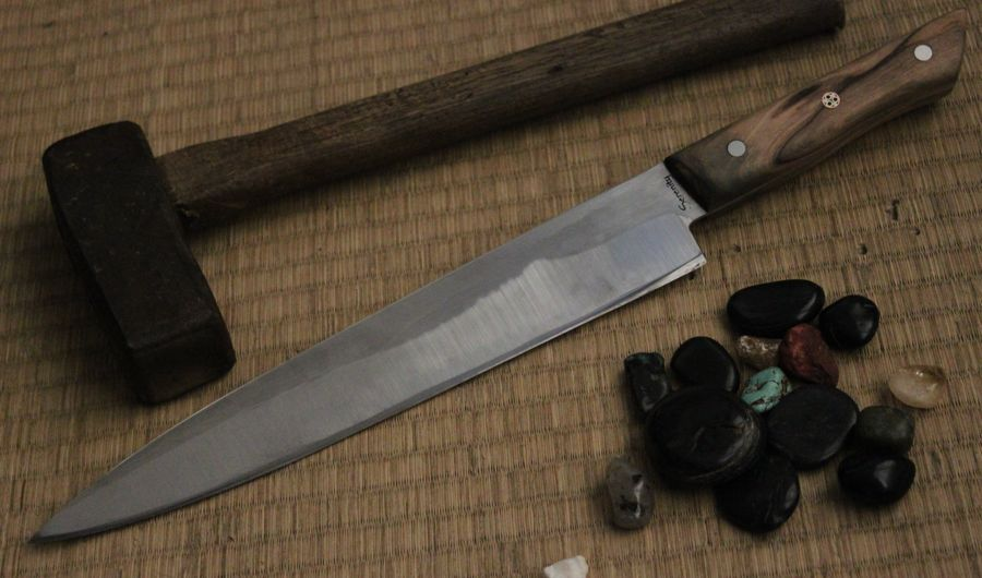 "Sashimi knife in 1084 steel, with Olive wood handle, 1/4"" outer pins 1/4"" center mosaic pin, the blade is 10 3/4"" handle is 5 1/2"""