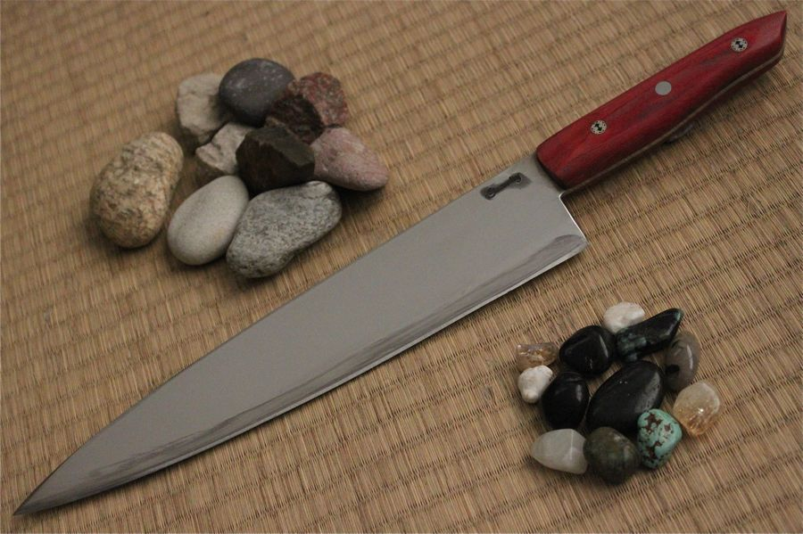 Chef's knife in 13C26 with Red Linen Micarta handle.