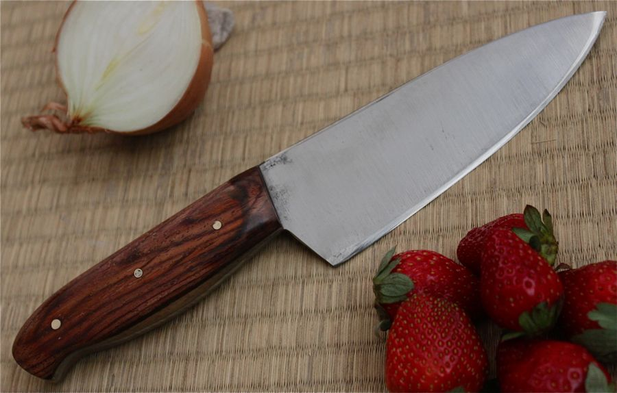 "6"" Chef's Knife or Kitchen Utility knife. Texas Ebony handle one side is cream the other dark. Very nice contrast."