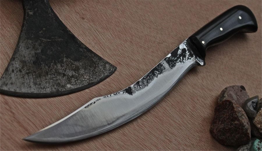 "A smaller 'Aregon's Hunting Knife' Water buffalo horn handle, buffed forge finish, 3- 1/8"" brass pins, 7"" long."