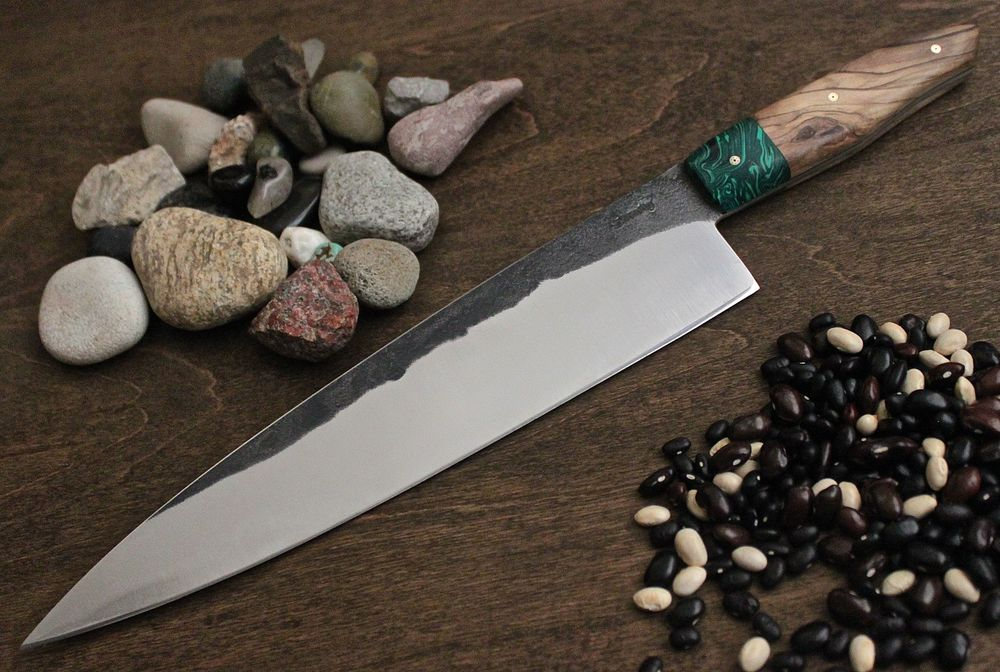 A french style custom knife. 1084 steel malachite bolster with Olive wood handle.