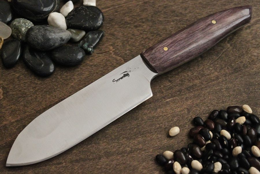 A custom order vegetable knife, 1084 steel with stabilized camel bone handle.