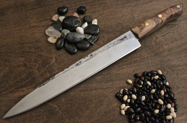 "11 5/8"" Sushi Knife, made in 1084 Steel, Olive wood handle with 1 - 1/4"" mosaic pin, 2 - 1/4"" front brass pins. This knife is 1 1/2"" deep at the heel."