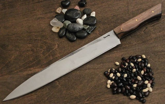 "11 5/8"" Sushi Knife, made in 1084 steel, Cocobolo handle with 3 - 1/8"" brass pins.  This knife is 1 1/2"" deep at the heel."